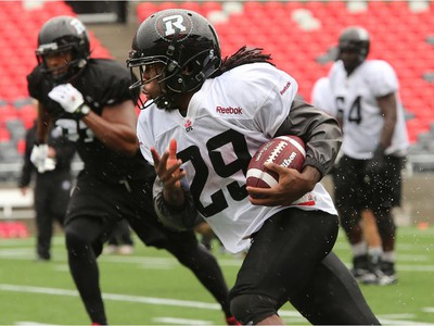 Ottawa Redblacks practice through a downpour Tuesday morning at TD Place Stadium at Lansdowne Park.