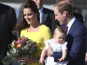 Britain's Prince William holding his son Prince George and his wife Kate, Duchess of Cambridge, arrive in Sydney Wednesday, April 16, 2014. The royal couple are on a three-week tour of Australia and New Zealand, the first official trip overseas with their son, Prince George.