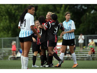 Women's Ottawa Fury FC celebrate a goal against Kitchener-Waterloo United FC during play action at Algonquin College Field on Saturday, July 19, 2014.