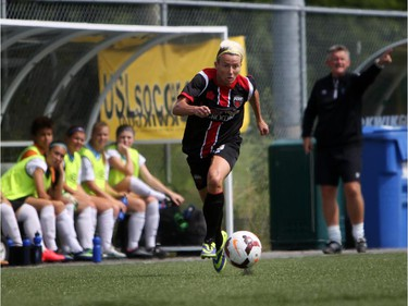 Women's Ottawa Fury FC's Kristy Moore eyes a ball as rushes upfield against Kitchener-Waterloo United FC during play action at Algonquin College Field on Saturday, July 19, 2014. (Cole Burston/Ottawa Citizen)