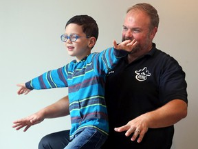Dr. Tony Sandorfi, from The Happy Spine Wise Body Studio in Westboro, tests six-year-old Mason Seguin's posture.
