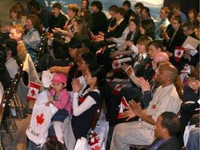 (OTTAWA, ONT: MARCH 30, 2009) CITIZENSHIP--Canadian Science and Technology Museum--Fifty newcomers from 31 countries attended a citizenship ceremony this morning in partnership with the Canadian 4-H Council.  New citizens applaude after swearing in ceremony. (PAT McGRATH/THE OTTAWA CITIZEN)  for Katie Daubs CITY story ASSIGNMENT NO. 94420