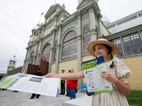 Maddie Fulford, 10, hands out welcoming flyers at the official opening of Lansdowne Park, culminating more than a year of intensive construction to complete the new 18-acre urban park.