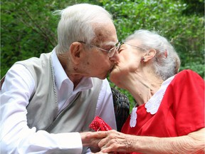 War veteran George Spear, 94, and his war bride, Jean Spear, 91, celebrated their 72nd wedding anniversary with a loving kiss during a tea party hosted in their Ottawa backyard on Friday, August 22, 2014.