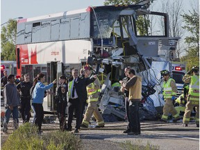 The front of an OC Transpo bus is barely distinguishable after a horrific crash between the double decker bus and a Via train near the Fallowfield station in Barrhaven on Sept. 18, 2013.