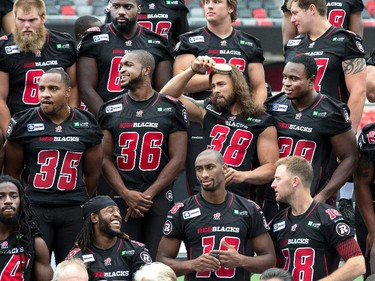 Linebacker James Green brushes his hair to look his best as the Ottawa Redblacks had their official team photos taken at TD Place.