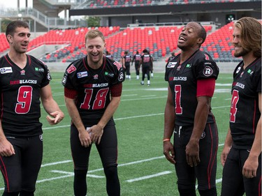 Quarterbacks Danny O'Brien (from left), Joey Elliott, Henry Burris and Alex Carder have a light moment as the Ottawa Redblacks had their official team photos taken at TD Place.