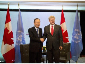 Prime Minister Stephen Harper, right, shakes hands with United Nations Secretary General Ban Ki-moon as they attend the Maternal, Newborn and Child Health Summit in Toronto on May 29, 2014.