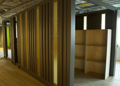 A shipping container is re-imagined in the new Shopify offices at 150 Elgin St. in Ottawa Friday, October 17, 2014. Each coloured cabin-like structure is a work-space where employees can meet in private or work. (Darren Brown/Ottawa Citizen)