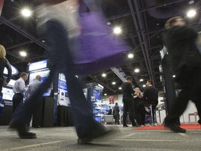 People attend the 22nd Government Technology Exhibition and Conference at the Shaw Centre Thursday.