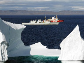 20 August 2008 Hudson Strait, Arctic Ocean   HMCS Toronto and the Canadian Coast Guard Ship (CCGS) Pierre Radisson sail past an iceberg in the Hudson Strait off the coast of Baffin Island. Both ships are part of Operation NANOOK.   Operation NANOOK is a Canada Command sovereignty operation, taking place in Canadaís arctic waters.  Ranging from Iqaluit on Baffin Island to the Hudson Straits area, the operation will include joint co-operation from Army, Navy, and Air Force units, training Canadian Forces personnel to support other government departments.  In close cooperation with the Coast Guard and RCMP, operations such as NANOOK increase inter-department effectiveness, in addition to bolstering Canadaís presence in her northern territories.   Photo by: Sergeant Kevin MacAulay  Can be used with Andrew Mayeda (Canwest) story