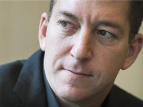Journalist Glenn Greenwald poses for a photograph in Montreal, Thursday, October 23, 2014.