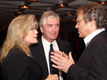 Heritage Minister Shelly Glover in conversation with Michel Roy, chair of the Telefilm Canada board, and film producer Richard Goudreau, right, at the Ottawa premiere of Elephant Song,  at the National Arts Centre on Monday, Sept. 29, 2014.