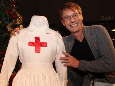 Local actor Guy Buller poses with such movie-themed decor as this nurse costume on display at the reception for the Ottawa premiere of the Elephant Song at the National Arts Centre on Monday, Sept. 29, 2014.