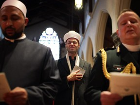 Tears roll down the cheeks of Imam Mohamed Jebara of the Cordova Spiritual Education Centre during an interfaith service, 'A Prayer for Ottawa' at Christ Church Cathedral Ottawa on Sunday, October 26, 2014.