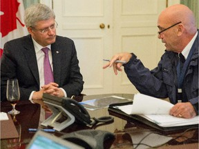 This photo provided by the Prime Minister's office shows the head of RCMP Bob Paulson briefs Canadian prime Minister Stephen Harper on the shootings at  Parliament Hill in Ottawa on Wednesday Oct. 22, 2014.  A soldier standing guard at the National War Memorial was shot by an unknown gunman and people reported hearing gunfire inside the halls of Parliament.  (AP Photo/Canada Prime Minister Office)