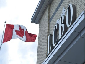 A Canadian flag flies near an under construction LCBO store in Bowmanville, Ontario on Saturday July 20, 2013.