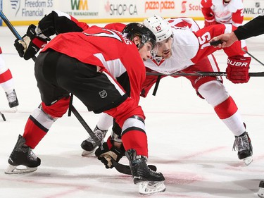 Kyle Turris #7 of the Ottawa Senators prepares for a faceoff against Riley Sheahan #15 of the Detroit Red Wings.