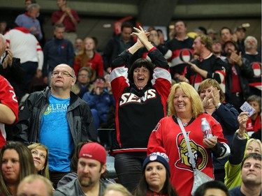 Fans enjoy the Sens goal in the second period.