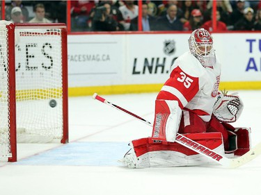 Jimmy Howard looks back at the game winning goal in the third period.