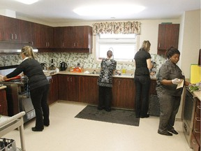 Staff prepare food for the opening of the new Interval House, a shelter for abused women, in Ottawa, February 16, 2012.