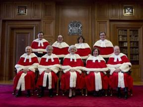 The Supreme Court Justices pose for a group photo at the Supreme Court of Canada Monday October 6, 2014 in Ottawa. Back Left: Justice Richard Wagner, Justice Michael J. Moldaver, Justice Andromache Karakatsanis, Justice Clement Gascon. Front Left: Justice Marshall Rothstein, Justice Louis LeBel Chief Justice Beverly McLachlin, Justice Rosalie Silberman Abella Justice Thomas Albert Cromwell.