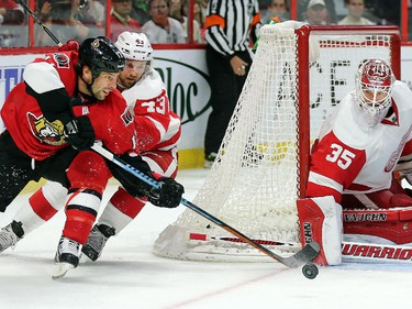 With Darren Helm close behind, David Legwand attempts a wrap around with Jimmy Howard getting his blocker down in time in the third period.