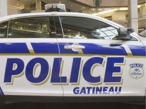 Gatineau police arrested two men and seized a rifle and ammunition in raids Thursday.