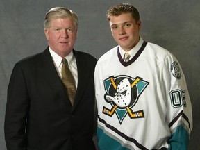 Bobby Ryan is pictured with general manager Brian Burke after being selected No. 2 overall by the Mighty Ducks of Anaheim in 2005.