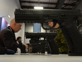A handgun manufacturer product is displayed at the CANSEC trade show in Ottawa on Wednesday, May 28, 2014.
