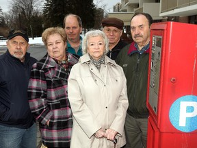 Residents of Montfort Manor from left: Andy Charette, Michele Girard, Stephen Maclellan, Fernande Louis-Seize, Louis Bourre and Chuck Bergeron are upset about their old visitor's parking spots being converted to pay-parking spots.