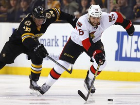 The Ottawa Senators' Zack Smith skates away from the Boston Bruins' Reilly Smith on Saturday, Dec. 13, 2014. Smith will miss significant time after dislocating his wrist in the same game.