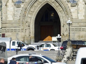 RCMP and Ottawa Police are searching for potential of other shooters after a shooter was reported to be shot dead Oct 22 by security at Parliament Hill. A soldier at the War Memorial Cenotaph was shot just moments before. The soldiers condition is unknown at this time. (Pat McGrath / Ottawa Citizen)