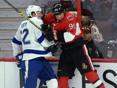 Ottawa Senators' Alex Chiasson hits Tampa Bay Lightning's Andrej Sustr during second period NHL hockey action in Ottawa on Sunday, Jan 4, 2015.