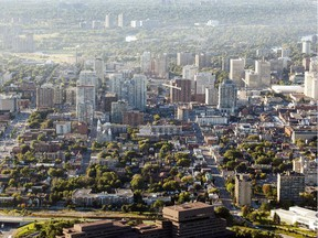 An aerial photograph taken from a hot air balloon shows downtown Ottawa and the Byward Market in Friday, August 29, 2014. The 27th Gatineau Hot Air Balloon Festival got under way Friday and runs for five days. (Darren Brown/Ottawa Citizen)