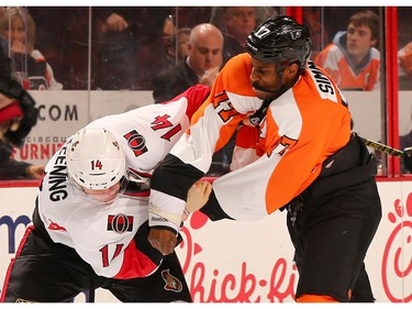 Colin Greening #14 of the Ottawa Senators and Wayne Simmonds #17 of the Philadelphia Flyers fight in the second period.