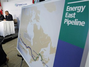TransCanada CEO Russ Girling, right, and TransCanada president of energy and oil pipelines Alex Pourbaix announce the company is moving forward with the 1.1 million barrel-per-day Energy East Pipeline.