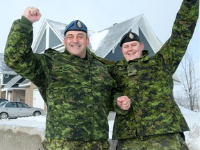 Sgt. Mario Legnaro (left) and Cpl. Andrew Price were among the crew of soldiers who helped a family move into their new Habitat for Humanity home in Orléans recently.