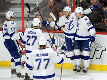 Tampa Bay Lightning's Steve Stamkos, second from right, celebrates a second period goal with teammates while taking on the Ottawa Senators in NHL hockey action in Ottawa on Sunday, Jan 4, 2015.