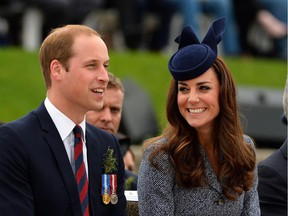 Britains Prince William (L) and his wife Catherine, Duchess of Cambridge, share a smile during the ANZAC Day march at the Australian War Memorial in Canberra on April 25, 2014. Britain's Prince William, his wife Kate and their son Prince George were on a three-week tour of New Zealand and Australia.