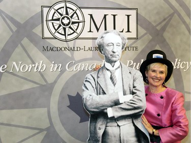 Mary de Toro, chair of the Ottawa branch of the Monarchist League of Canada, poses with a life-size cardboard cutout of Sir John A. Macdonald at a special dinner hosted by the Macdonald-Laurier Institute at the Canadian Museum of History on Wednesday, February 18, 2015.