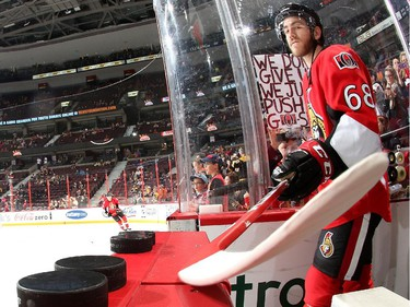 Mike Hoffman #68 of the Ottawa Senators reaches for warmup pucks with his stick prior to a game against the Boston Bruins.