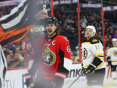 Erik Karlsson, left, of the Ottawa Senators and Gregory Campbell of the Boston Bruins both receive penalties during second period NHL action.