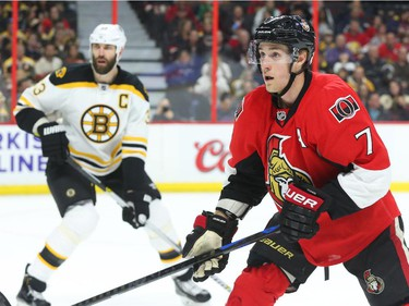 Kyle Turris of the Ottawa Senators in action against Zdeno Chara and the Boston Bruins during first period NHL action.