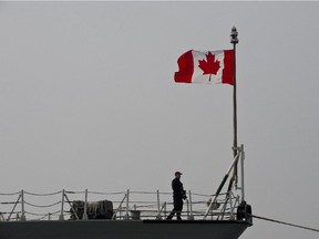 A Canadian soldier stands on board the HMCS Fredericton.