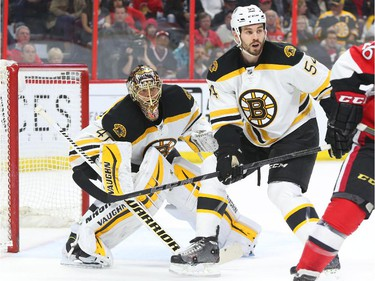 Tuukka Rask, left, and Adam McQuaid of the Boston Bruins in action against the Ottawa Senators during first period NHL action.