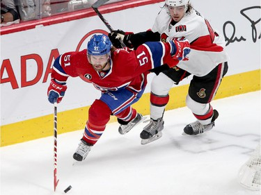 David Desharnais is chased by Jean-Gabriel Pageau in the first period as the Ottawa Senators take on the Montreal Canadiens at the Bell Centre in Montreal for Game 5 of the NHL Conference playoffs on Friday evening.