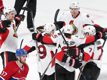 Mark Stone joins Milan Michalek, Patrick Wiecioch, Kyle Turris and Erik Karlsson to celebrate the third Senator goal in the second period as the Ottawa Senators take on the Montreal Canadiens at the Bell Centre in Montreal for Game 5 of the NHL Conference playoffs on Friday evening. Assignment - 120437 Photo taken at 20:36 on April 24. (Wayne Cuddington / Ottawa Citizen)