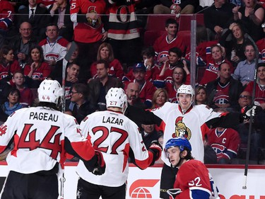 Patrick Wiercioch #46 of the Ottawa Senators celebrates his first period goal with teammates during Game Five of the Eastern Conference Quarterfinals of the 2015 NHL Stanley Cup Playoffs at the Bell Centre on April 24, 2015 in Montreal, Quebec, Canada.