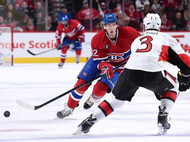 Dale Weise #22 of the Montreal Canadiens passes the puck in front of Marc Methot #3 of the Ottawa Senators during Game Five of the Eastern Conference Quarterfinals of the 2015 NHL Stanley Cup Playoffs at the Bell Centre on April 24, 2015 in Montreal, Quebec, Canada.